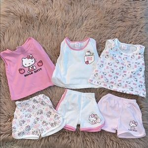 Three sets of hello kitty outfits